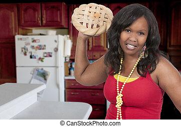 Pie Fight - Beautiful woman having a friendly pie fight