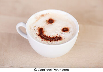 cup of cappuccino with smiley face on millk foam