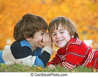 Boys Telling Secrets - Boy Whispering in Little Boys Ear