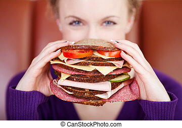woman with giant sandwich - woman holding very big sandwich...