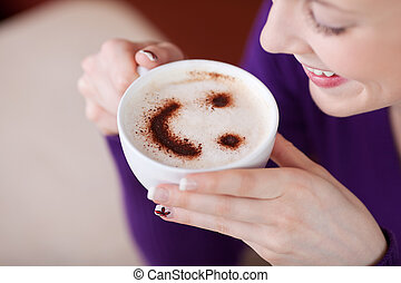 Woman Having Cappuccino In Cafe - Happy woman having...