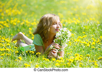 Spring mood -  Beautiful girl with  branch of an apple-tree