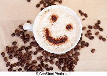 Smiley Face In Cappuccino With Coffee Beans On Table -...