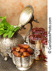 Ramadan treat - Moroccan tea tray with mint leaves and...