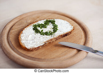 slice of bread with cheese and a heart of herbes