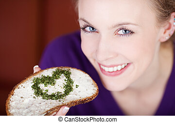 healthy nutrition with heart - woman having bread with...