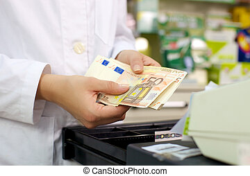 Euros banknotes in pharmacy closeup detail