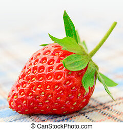 Fresh Sweet Strawberries on the Table Cloth - Close up of...