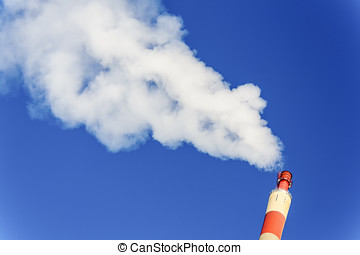 fuming industrial chimney - chimney of an industrial company...