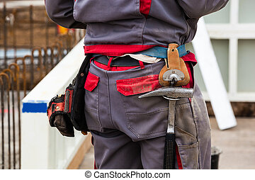 construction worker at a building site - construction...
