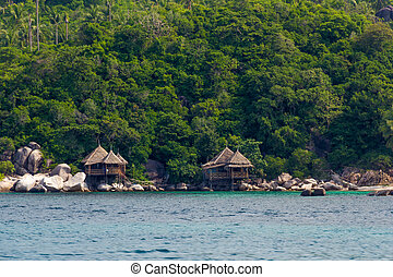 Bungalows on the rocks by the sea on Koh Tao, Thailand