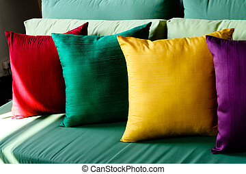Colorful silk cushions - Colorful silk pillows on a sofa -...