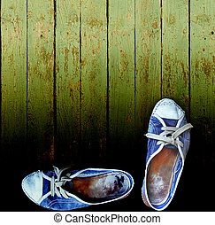 worn jeans gym shoes against a wooden plank wall - My best...