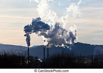 smoking chimneys of a factory - the smoking chimneys of a...
