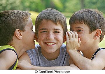 Boys Telling Secrets - Two Boys Laughing Telling Secrets