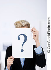 Businesswoman Holding Paper With Question Mark
