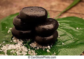 Hot Stones - Hot stones used for hot stone therapy on a big...