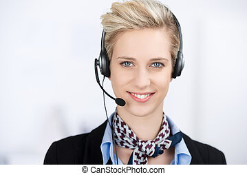Female Customer Service Executive Wearing Headset - Portrait...
