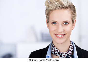 Confident Businesswoman Smiling In Office - Portrait of...