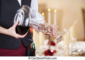 Waitress Pouring Red Wine In Wineglass - Midsection of...