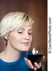 Young Blond Woman With Red Wine Glass - Young blond woman...