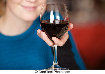 Young Woman Holding Red Wine Glass - Young woman holding red...
