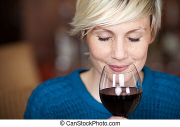 Female Customer Drinking Red Wine With Eyes Closed - Closeup...