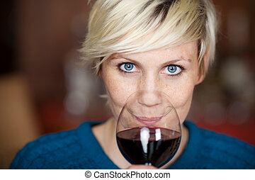 Female Customer Drinking Red Wine In Restaurant - Closeup...