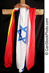 cross - A wood cross with three flags and a crown of thorns...