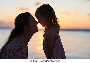 Mother and daughter silhouettes - Silhouettes of mother and...