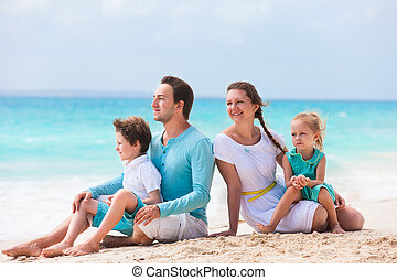 Family on a tropical beach vacation - Portrait of a...
