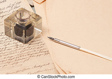 Vintage old papers, old ink pen, handwrite letters and old ink pot