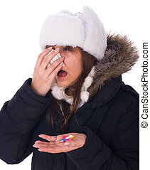 Head cold - Young woman have head cold and holding pills