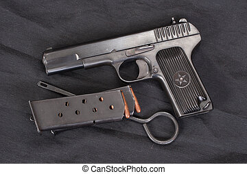 Soviet handgun on black background