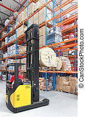 Forklift loading roll pallet in distribution warehouse
