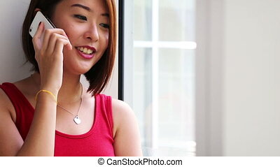 Phone Call  - An asian young lady making a phone call.