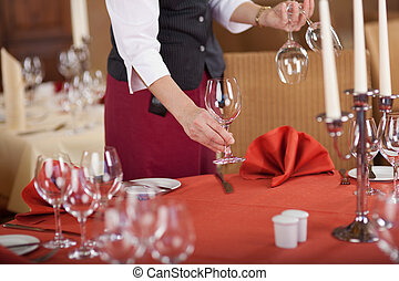 Waitress Arranging Wineglasses On Restaurant Table -...