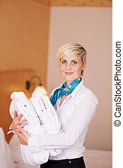 Female Housekeeper With Bathrobes - Portrait of happy female...