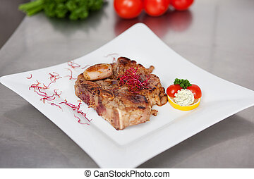 Garnished Meat In Plate On Kitchen Counter - Closeup of...