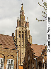 Bell tower of Our Lady Church in Brugge - Belgium. - View on...