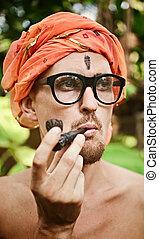 Man smoking pipe in glasses