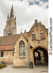 The Memlingmuseum in background bell tower of Our Lady...