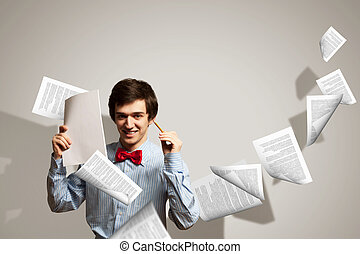 Tired young man - Image of young tired man holding folder...