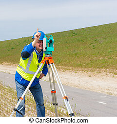Engineer and Total station or theodolite - Engineer working...