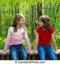 children friend girls talking on the jungle park forest -...