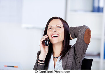 Laughing woman speaking on a telephone - Laughing woman with...