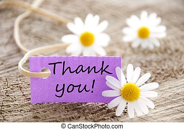 label with Thank you - a purple label with Thank you on it...