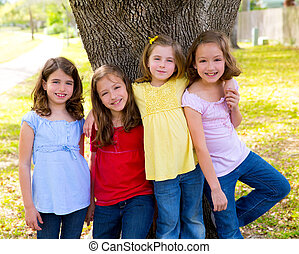 Children group friend girls playing on tree