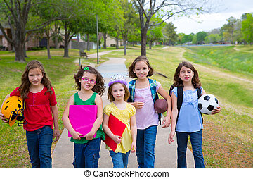 Children kid girls walking to school with sport balls...