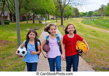 Children kid girls walking to school with sport balls...